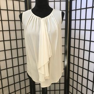 Cream sleeveless blouse